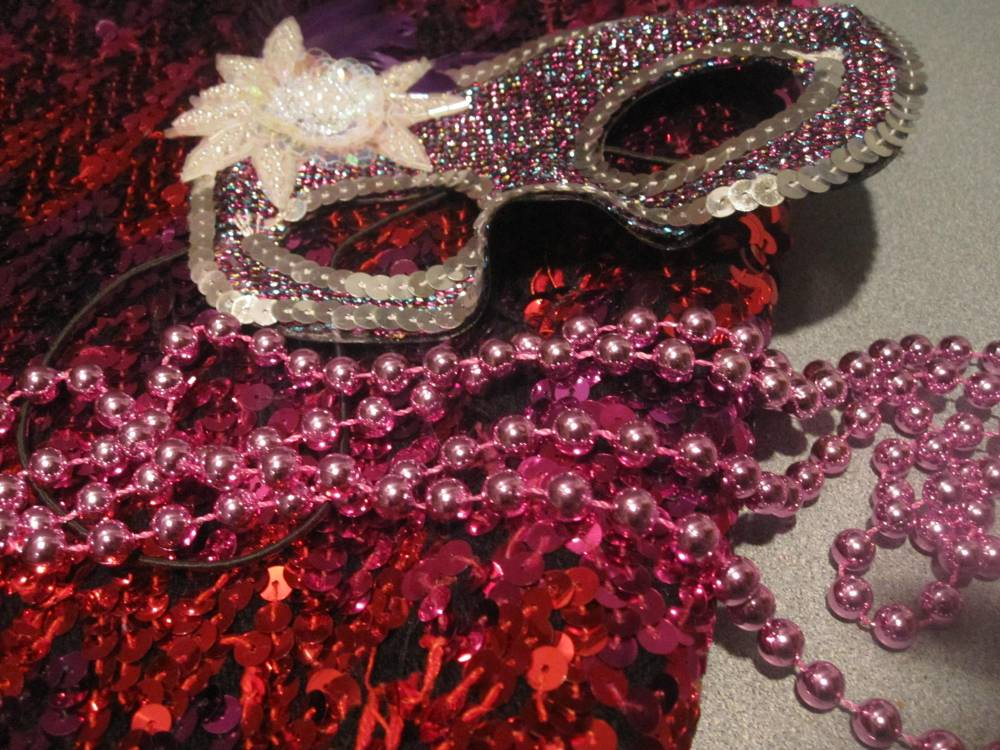 PInk sequins, mardi gras beads, masquerade mask to symbolize stagette party
